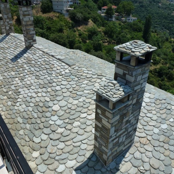 Flagstone bekapte leien op het dak
