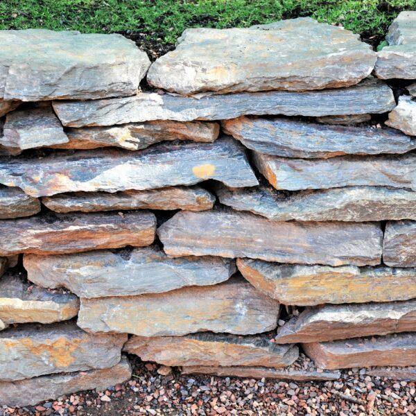 Gestapelde Flagstone Muur.